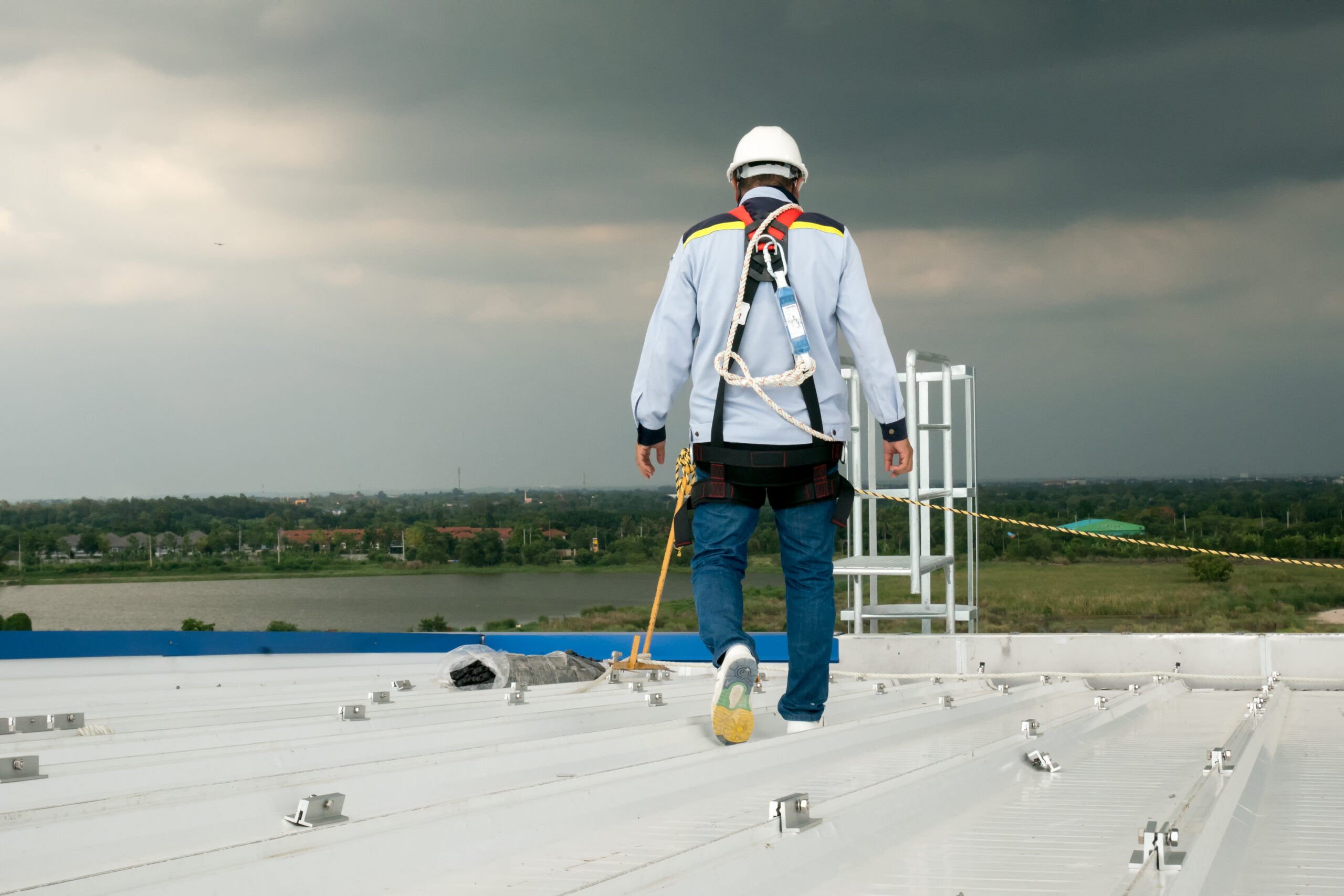 commercial roof inspection man on roof